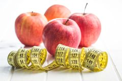 Red apple and measuring tape. Royalty Free Stock Photography