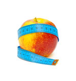 Red apple and measuring tape on white background Royalty Free Stock Image