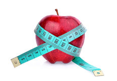 Red apple with measuring tape  on white Royalty Free Stock Images