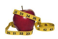 Red apple with measuring tape stock photography