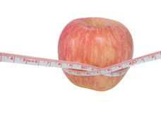 Red apple measuring Royalty Free Stock Photo