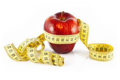 Red apple and meter Stock Images
