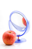 Red apple and a mirror with a reflection Royalty Free Stock Image