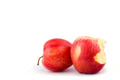Red apple with missing a bite on white background healthy apple fruit food isolated Stock Photos