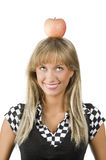 Red apple on my head. Cute young girl with a red apple on her head making face Stock Photos