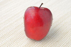 Red apple on napery Royalty Free Stock Images