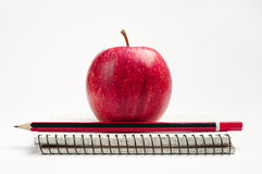 Red apple and notebook Royalty Free Stock Image