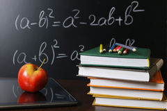 Red apple on notebook with book. Stack Stock Photos