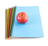 Red apple and notebooks Stock Photography