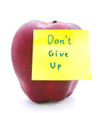Red apple and notepad don't give up Royalty Free Stock Photo