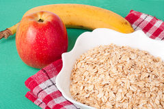 Red apple and oat flakes in a bowl Royalty Free Stock Photos