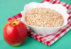 Red apple and oat flakes in a bowl Stock Photography