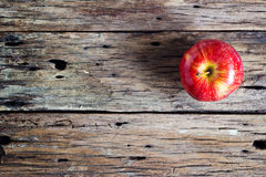 Red apple on old old wooden table Stock Photo
