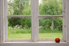 Red apple at an old windowsill Royalty Free Stock Photos