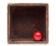 Red apple. In old wooden box on white background Royalty Free Stock Photography
