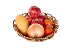Red apple, onion, mango and tomato on basket for healthy diet an Stock Images