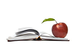 Red apple and open book. Close up of red apple and open book Royalty Free Stock Image