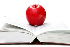 Red apple on an open book. Royalty Free Stock Image