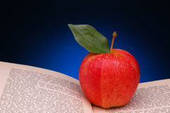 Red Apple on Open Book Royalty Free Stock Photo