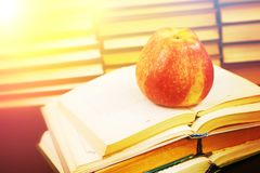Red apple on the opened book Stock Images