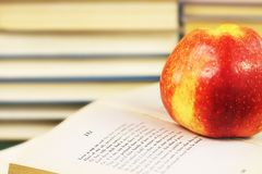 Red apple on an opened book Stock Image