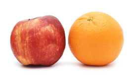 Red apple and orange. Isolated over white background Royalty Free Stock Photo