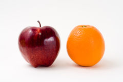 A Red Apple and an Orange Stock Image