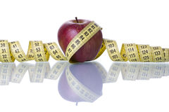 Red apple over a measure tape Royalty Free Stock Images