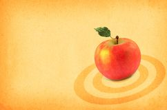Red apple on paper. Close-up of red apple against retro paper background Royalty Free Stock Image