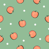 Red apple pattern on green background Royalty Free Stock Photos