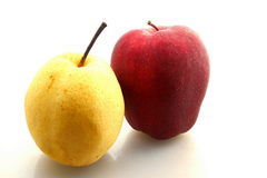 Red apple and pear. On white background stock photo