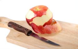 Red apple, peel and knife Royalty Free Stock Photo