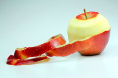 Red apple with peeled skin Royalty Free Stock Images