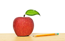 Red apple and pencil Stock Photography