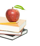 Red apple and pencil on books Stock Image