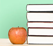 Red apple and pile of books Stock Image