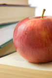 Red apple and pile of books. Photo close up Stock Photography