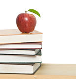 Red apple on pile of books Stock Photo
