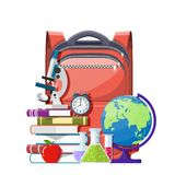 Education and study learning concept. Red apple on pile of books, alarm clocks, globe and school backpack. Education and study learning concept. Back to school Royalty Free Stock Image