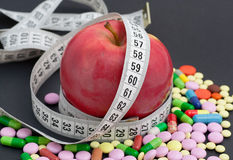 Red apple and pill Stock Image