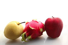 Red apple pitaya and pear. On white background Royalty Free Stock Images