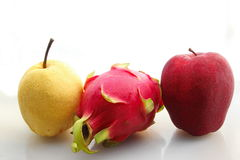 Red apple pitaya and pear. On white background Royalty Free Stock Photo