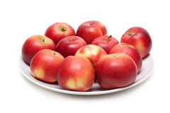 Red apple on plate Royalty Free Stock Image