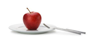 Red apple on plate Stock Photography