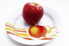 Red apple on plate Stock Photo