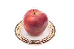 Red apple on plate Stock Photos
