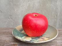 Red apple on plate Stock Images