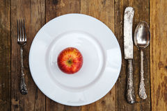 Red apple on a plate Royalty Free Stock Photo