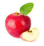 Red apple with a quarter and green leaf Stock Photos
