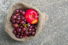 Red apple and red grapes Royalty Free Stock Images
